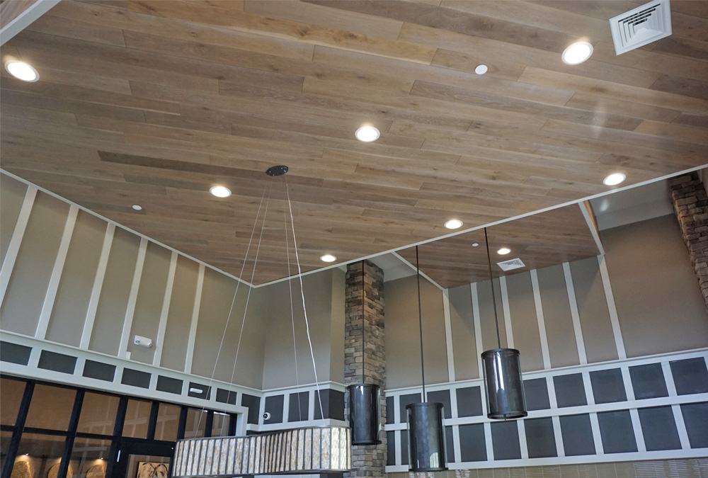 This unique drop ceiling made from suspended wood panels provides a unique design element to the game room ceiling in the apartment clubhouse