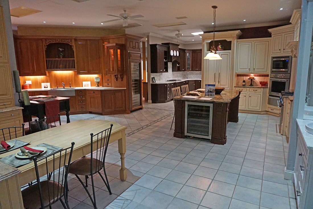 Photograph of the showroom at Kitchen Classics's in Milburn, Vauxhall, NJ showing a few of the 12 full size kitchen mock-ups.