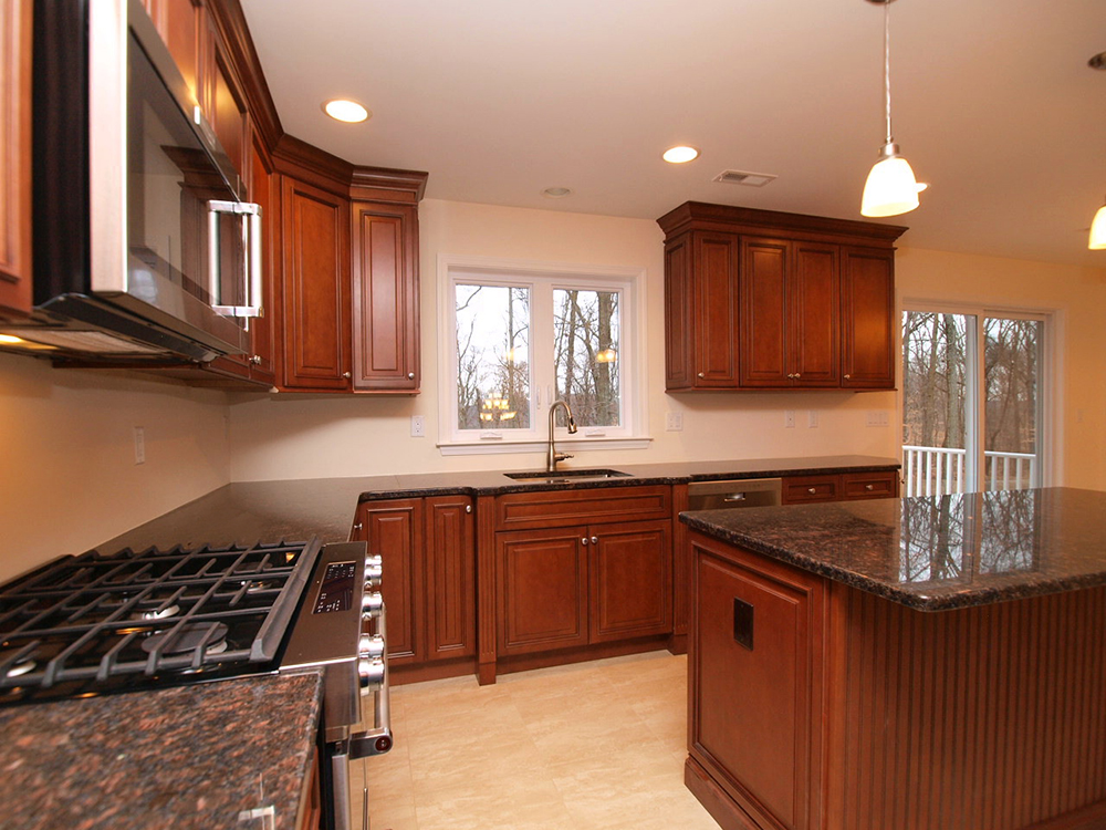 View of walnut stained kitchen cabinets including a corner cabinet