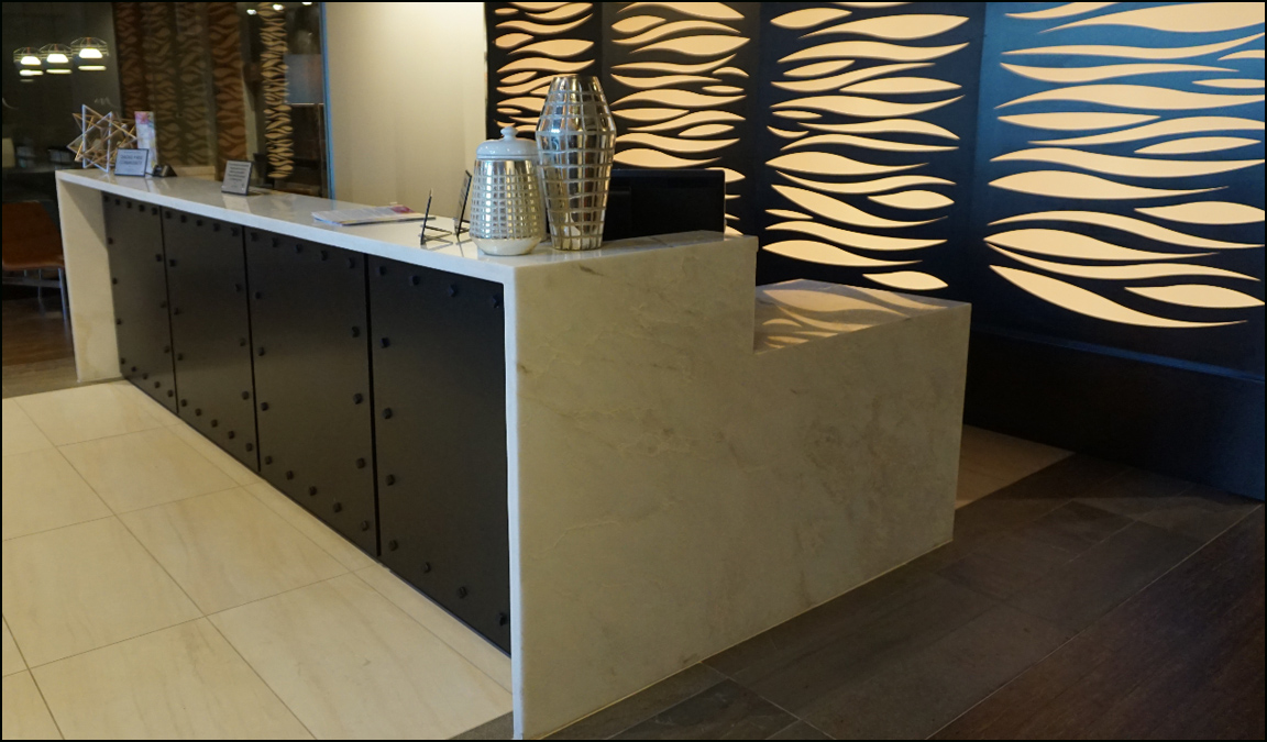 This apartment building lobby area has marble reception desk built by kitchen classics for Modera Lofts in Jersey City New Jersey