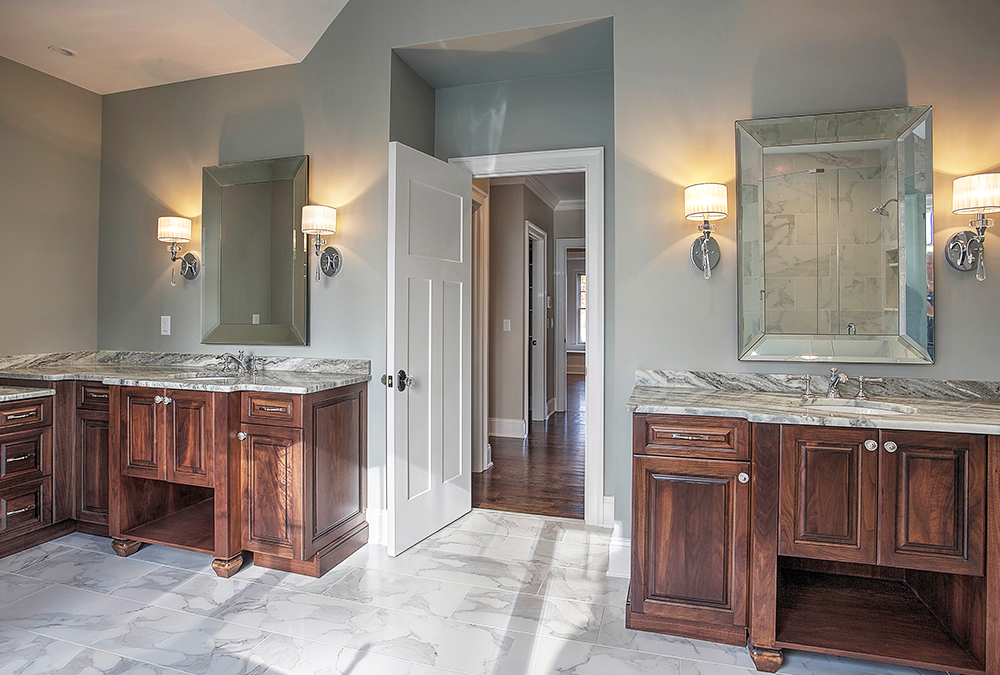 Master bathroom cabinetry in this warren new jersey new home showing his and her vanities