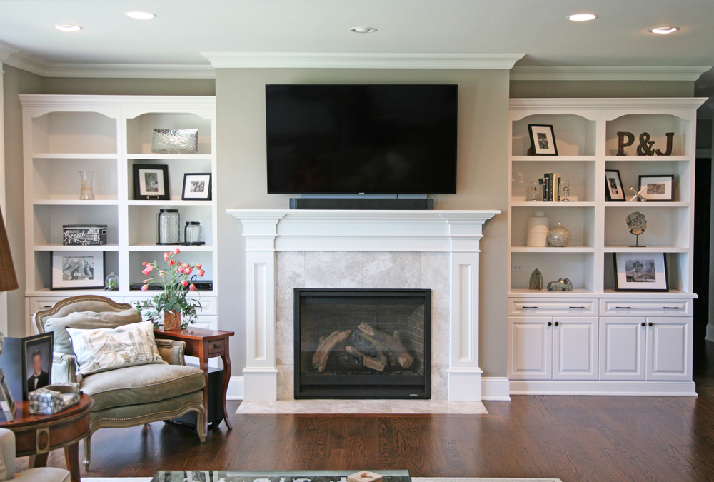 Custom bookcase in living room designed and installed by Kitchen Classics located in Union County New Jersey