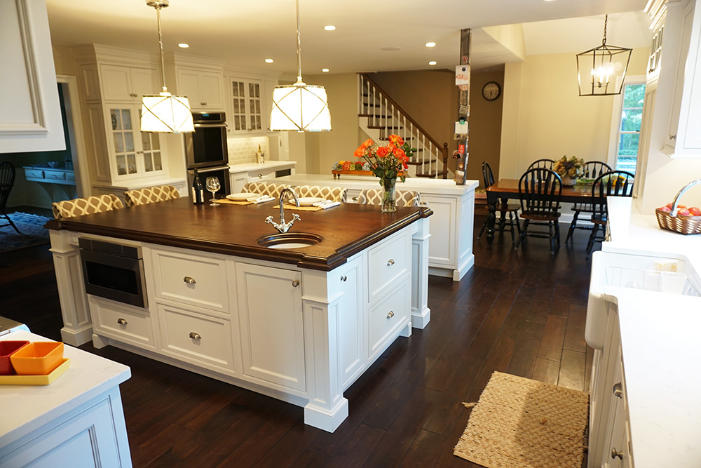 This photo shows the full size of the kitchen, both kitchen islands and the dining area in the background