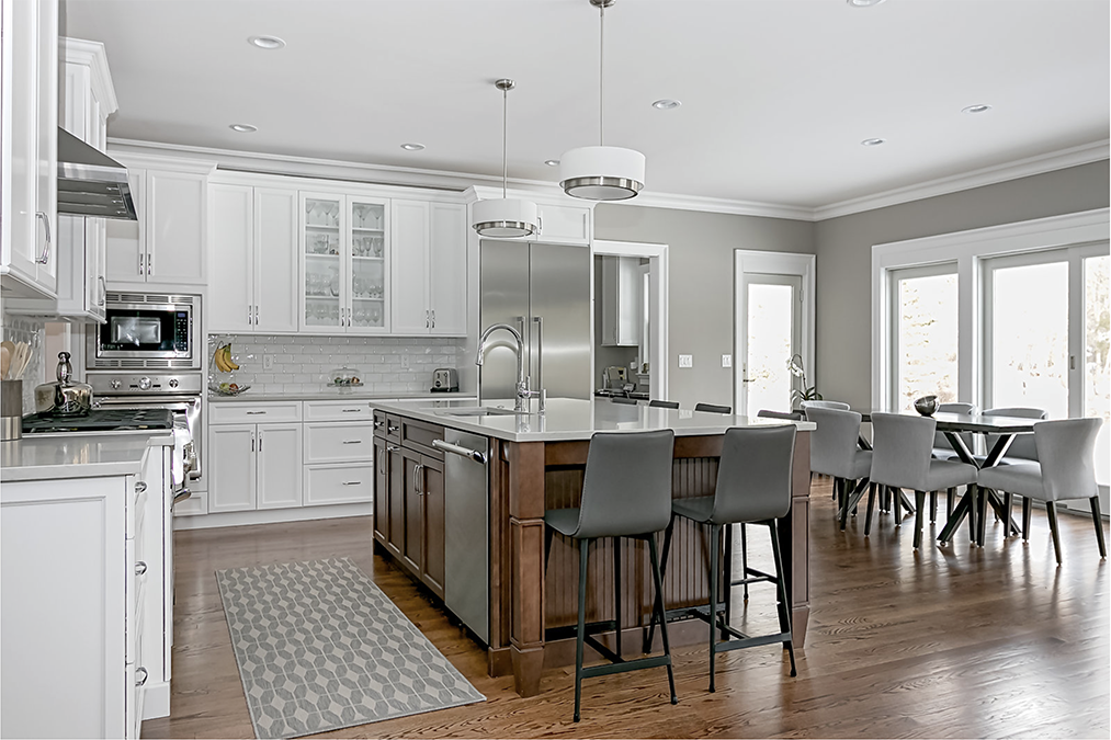 We designed and installed the kitchen, 3 bathrooms, and the laundry room amenities in this Somerset County home.