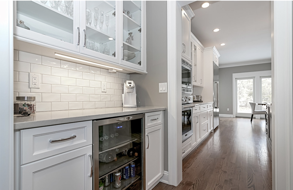 Modern Butler Pantry with increased storage and countertops is shown here