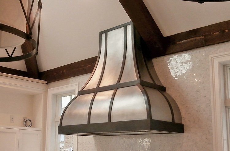 Picture of a custom metal hood in a new jersey kitchen